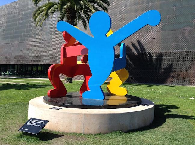 3 dancing figures