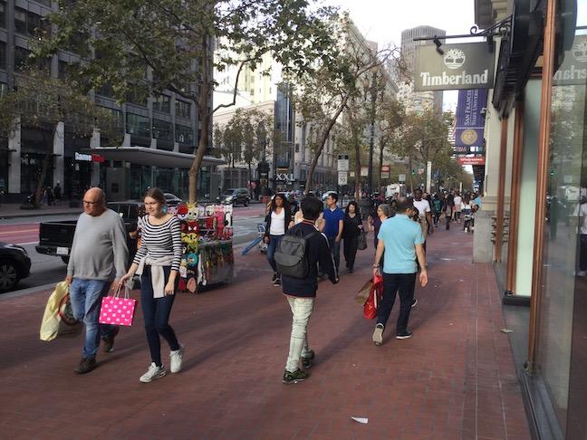 market street woman in striped shirt