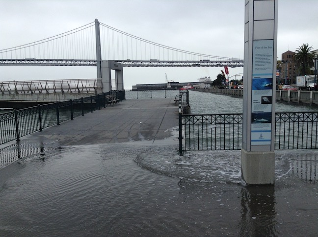 king tide at pier 14, arrow sculpture in background