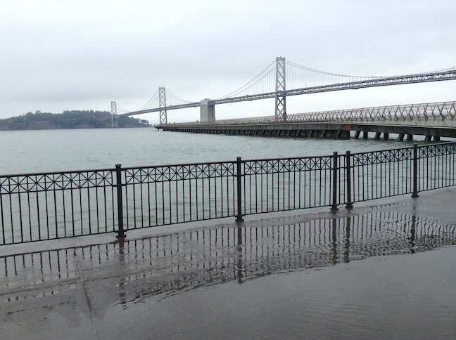 king tide at pier 14, bay bridge in background